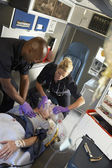 Paramedics performing CPR on patient in ambulance — Stock Photo