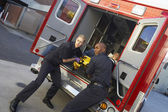 Paramedics preparing to unload patient from ambulance — Stock Photo