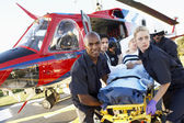 Paramedics unloading patient from Medevac — Stock Photo