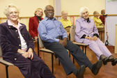 Senior adults in a stretching class — Stok fotoğraf