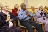 Senior adults in a stretching class — Stock Photo