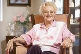 Senior woman relaxing in chair — Stock Photo