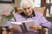 Senior woman reading book — Stock Photo