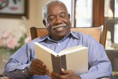 Senior man reading book — Stock Photo