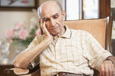 Senior man resting in armchair — Stock Photo