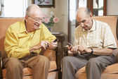 Senior men text messaging — Stock Photo