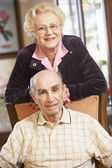 Senior couple relaxing in armSenior couple relaxing in armchairs — Stock Photo