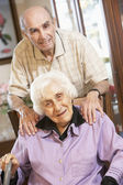Senior couple relaxing in armchairs — Stock Photo