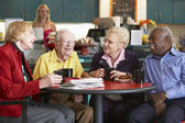 Senior adults having morning tea together — Stock fotografie