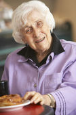 Senior woman having morning tea — Stock Photo