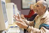 Senior man using computer — Stock Photo