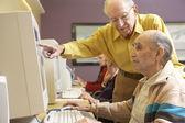 Senior men using computer — Stock Photo