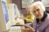 Senior woman using computer — Stock Photo