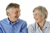 Portrait of senior couple smiling at each other — Stock Photo