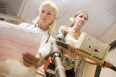 Doctor Monitoring The Heart-Rate Of Patient On A Treadmill — Stock Photo