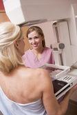 Nurse Assisting Patient Undergoing Mammogram — Stock Photo