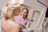 Nurse Assisting Patient Undergoing Mammogram — Stock Photo