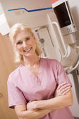 Portrait Of A Nurse In Front Of A Mammogram Machine — Stock Photo