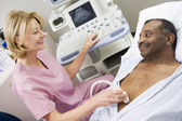 Nurse Giving Patient An Ultra Sound — Stock Photo