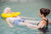 Instructor And Elderly Patient Undergoing Water Therapy — Stock Photo