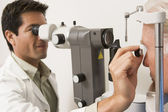 Doctor Checking Patient's Eyes — Foto Stock
