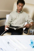 Patient Reading A Magazine While Being Monitored — Stock Photo