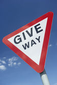 Give Way Sign Against A Blue Sky — Stock Photo