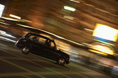Taxi Driving Through Night Time Street — Stock Photo