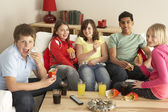 Group Of Children Eating Burgers At Home — Stok fotoğraf
