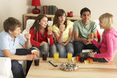 Group Of Children Eating Burgers At Home — Stock Photo