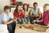 Group Of Children Eating Pizza At Home — Stok fotoğraf