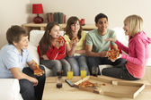 Group Of Children Eating Pizza At Home — Stock fotografie