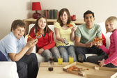 Group Of Children Eating Pizza Watching TV — Stock Photo