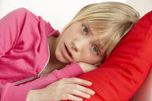 Young Girl Looking Sad On Sofa — Stock Photo