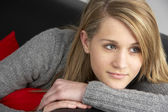 Teenage Girl Sitting On Sofa — Stock Photo