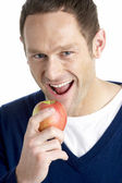 Man Taking Bite Of Apple — Stockfoto