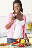 Woman Enjoying Glass Of Wine In Kitchen — Stock Photo