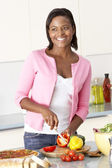 Woman Preparing Meal In Kitchen — Stock Photo