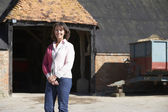 Farmer's Wife Standing In Front Of Farm Buildings — Stock Photo