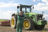 Driver Standing In Front Of Tractor — Stockfoto