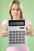 Woman Holding Calculator — Stockfoto