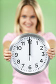 Woman Holding Clock Showing 12 O'Clock — Stock Photo
