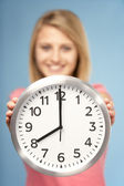 Teenage Girl Holding Clock — Stock Photo
