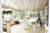 Woman Walking Through Conservatory — Stock Photo