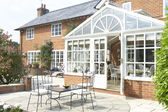 Exterior Of House With Conservatory And Patio — Stock Photo
