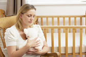 Sad Mother Sitting In Empty Nursery — Stock Photo