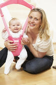 Baby In Bouncer With Mother — Stock Photo