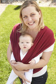 Baby In Sling With Mother Outdoors — Stock Photo