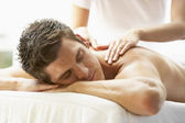 Young Man Enjoying Massage At Spa — Foto Stock