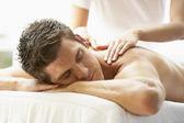 Young Man Enjoying Massage At Spa — Stock Photo
